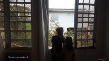 Our boys observe the damage from our blown window.